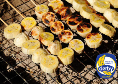 Bananas sausages on barbecue